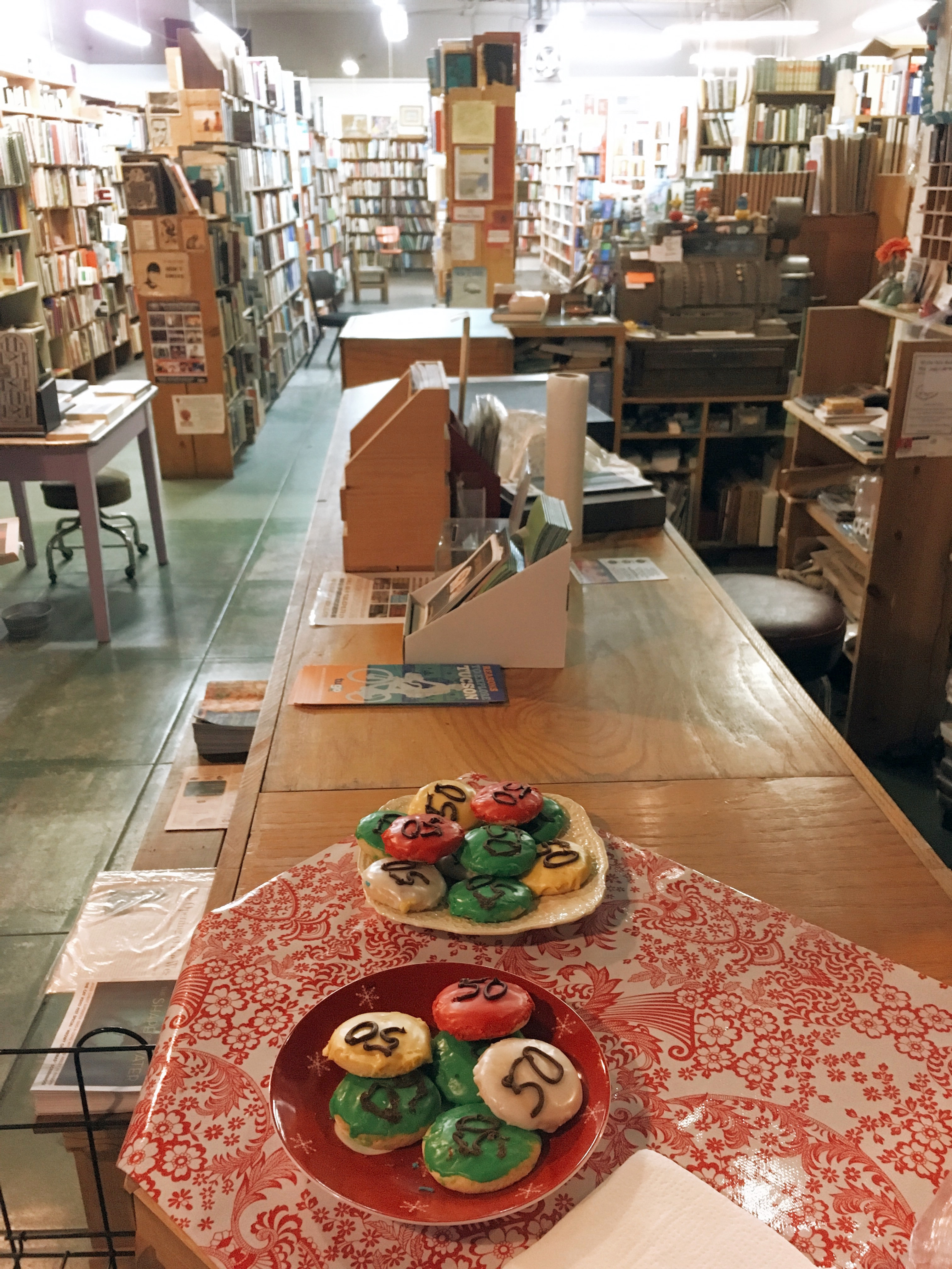 Plates of cookies sit on the counter at the Book Stop, which is celebrating its 50th anniversary.