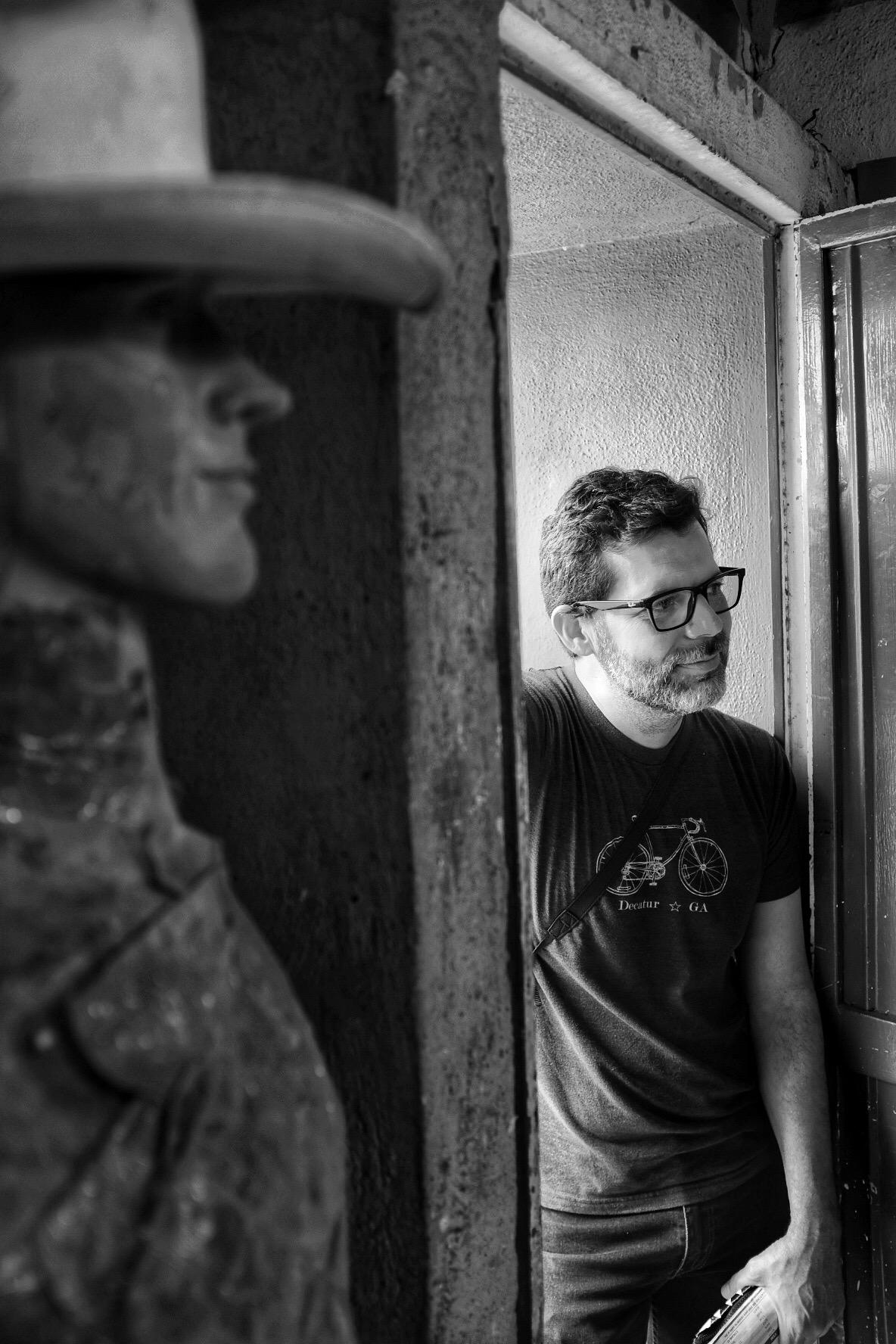 Hiram in the doorway of Frank's workshop
